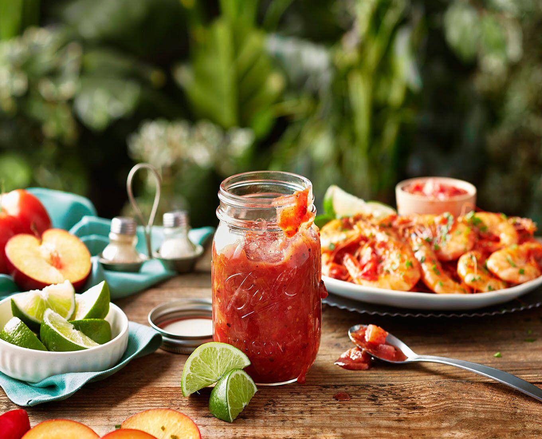Mason jar and food on outdoor table