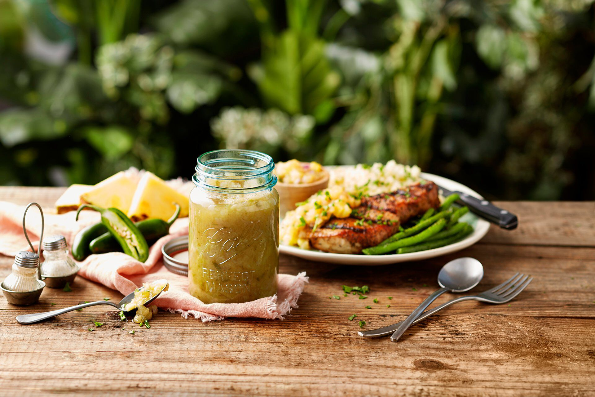 Mason jar and food on outdoor table